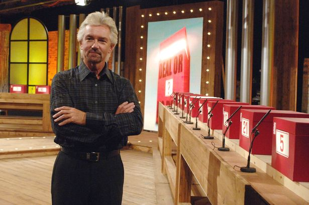 Noel Edmonds and red Deal or No Deal boxes