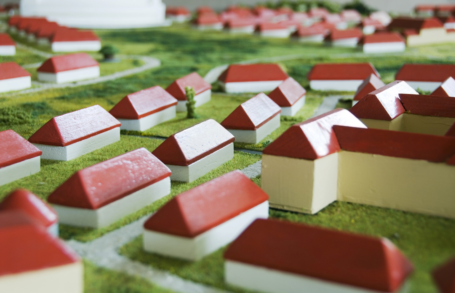 2355954-toy-model-village-red-and-white-houses-on-green