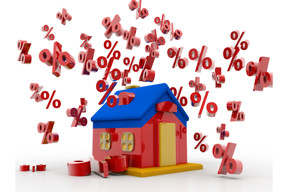 Percentage symbols tumble around a house