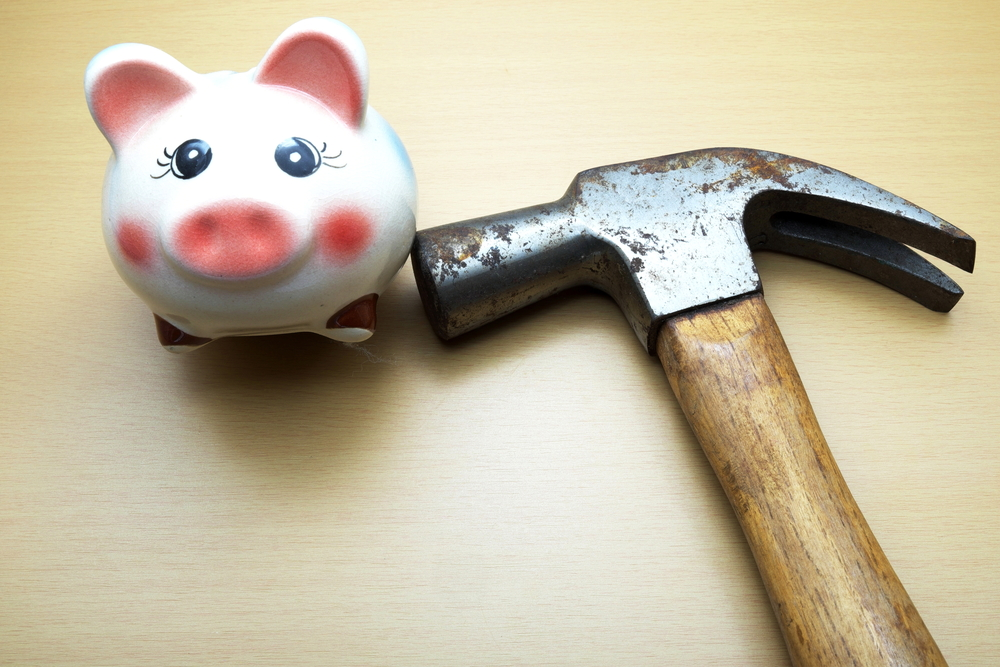 piggy bank and hammer
