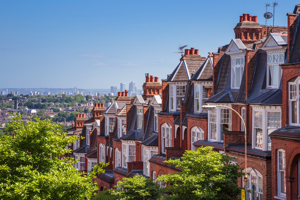 A row of terraced houses overlooks a view of London